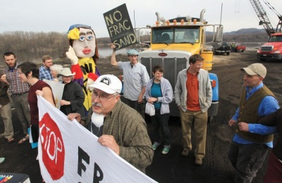 Steve Clemens holds sign at Winona Fracking Protest
