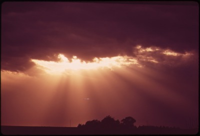 Photog_Charles_O-Rear_for_the_EPA_1973_-_SUN_RAYS_THROUGH_STORM_CLOUDS_OVER_GRAFTON,_IN_THE_FARMLANDS_WEST_OF_LINCOLN_-_NARA_-K.Kelly