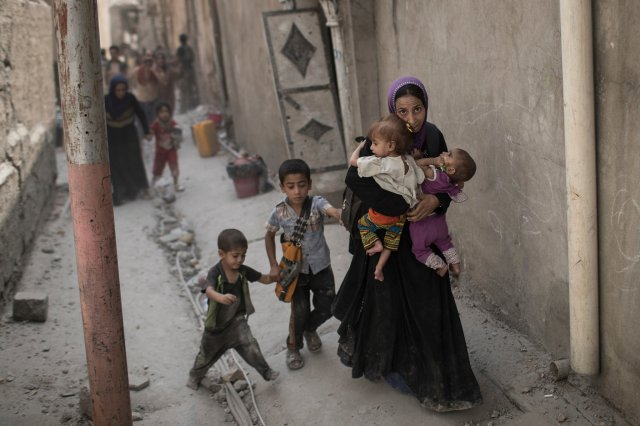 The liberation of Mosul: civilians were trapped while the city was being destroyed. Photo; Felipe Dana/AP