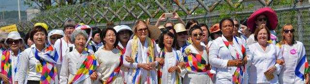An international delegation, along with women from North and South Korea, walked together along the DMZ (Demilitarized Zone) in 2015, advocating for an end to the Korean War and reunification on the 70th anniversary of the division of the Korean peninsula. womencrossdmz.org