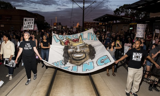 Protesters carry a banner depicting Philando Castile on June 16, 2017 in St. Paul Minnesota. Photo Stephen Maturen, Getty Images