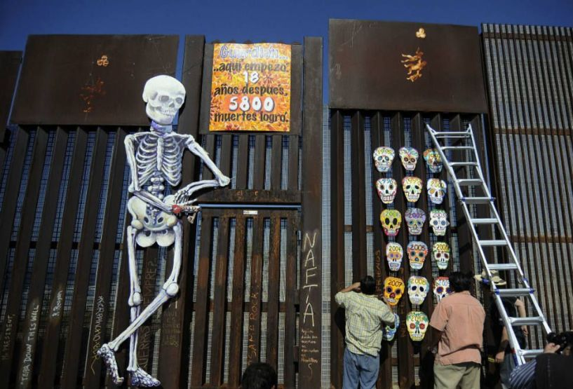 Art created on the border wall for Dia de los Muertos in 2012, commemorating the deaths of immigrants attempting to cross from Mexico to the US. Photo: TV Azteca